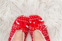 New Year`s, Christmas slippers for adults are dressed for the women. On white soft fur. Funny, funny, humorous, cozy,. New Year`s, Christmas slippers for adults Stock Images