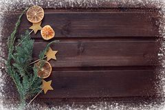 New Year`s Christmas snow background with oranges and stars of a stock photo