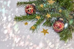 New Year`s, Christmas Still life with red balls and gold stars on the background of Christmas tree with bokeh. Horizontal. Close up. Copy space to the left royalty free stock image