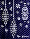 New Year`s or Christmas toy made of snowflakes with ribbon and bow. On a blue-and-black background Stock Photo