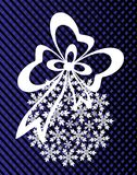 New Year`s or Christmas toy made of snowflakes with ribbon and bow. On a blue-and-black background Stock Images