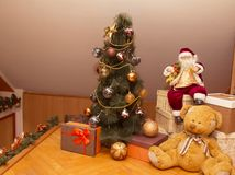 New Year`s Christmas tree decorated with gifts. New Year`s Christmas tree decorated with gifts, Santa Claus and Bear. 2019 year royalty free stock images