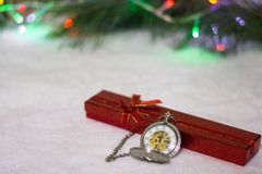 New Year`s clock. Christmas background. New Year`s clock and gift box. Christmas background Stock Photography
