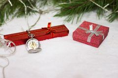 New Year`s clock. Christmas background. New Year`s clock and gift box. Christmas background Royalty Free Stock Images