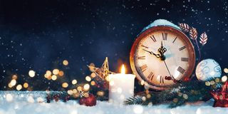 New Year`s clock. Decorated with balls, star and tree on snow