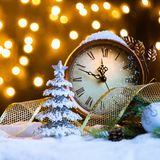 New Year`s clock with decoration on snow royalty free stock photography