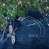 New Year`s clock with fir branches and balls. Abstract New Year`s background with clock, fir branches and decorations. for congratulations and invitations Stock Photography
