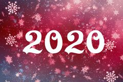 New year-2020. New year`s composition, the concept of the New year. Inscription 2020 red background with painted snow and snowflak stock photos