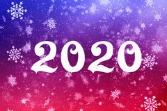 New year-2020. New year`s composition, the concept of the New year. Inscription 2020 red background with painted snow and snowflak stock photo
