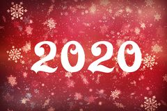 New year-2020. New year`s composition, the concept of the New year. Inscription 2020 red background with painted snow and snowflak royalty free stock photos