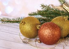 Golden balls, a golden thread and a new garland with branches of a Christmas tree. New Year`s composition, a golden thread, balls and a new garland with branches royalty free stock images