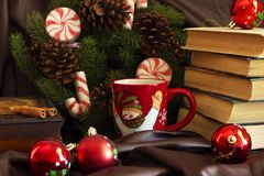 New Year`s composition from mugs, books, caskets, Christmas ball stock photography