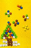 New Year`s composition from multi-colored sweets. New Year tree from a child`s pills. Children`s composition stock images