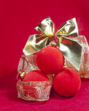 New Year's composition on a red background - ball and ribbon Stock Photo