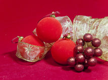 New Year's composition on a red background - ball and ribbon Royalty Free Stock Photo