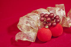 New Year's composition on a red background - ball and ribbon Royalty Free Stock Photography