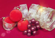 New Year`s composition on a red background - ball and ribbon Stock Photography