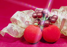 New Year`s composition on a red background - ball and ribbon Royalty Free Stock Images