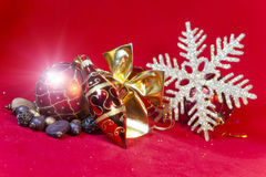 New Year`s composition on a red background - ball and ribbon Stock Photos