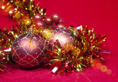 New Year`s composition on a red background - ball and ribbon Stock Photo