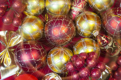 New Year`s composition on a red background - ball and ribbon Stock Image