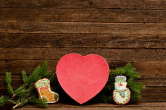 New Year`s concept. Box heart shaped gingerbread cookies, fir branch and gingerbreads Royalty Free Stock Photo