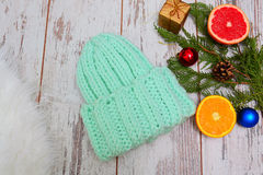 New Year`s Concept. Hat color of mint, citrus and Christmas tree decorations Stock Images