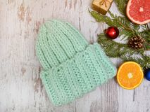 New Year`s Concept. Hat color of mint, citrus and Christmas tree decorations. Wooden background Stock Photography