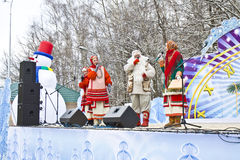 New Year's concert in park, Moscow. Moscow, Russia - January 02, 2012: New year's concert on open stage in Izmaylovskiy park, artists in national dress and in Stock Image