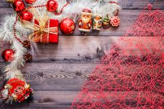 New Year`s decor and festive toys on a wooden table with a red string box with a gift Santa Claus and a Nutcracker. Happy New Yea