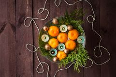 New Year`s decor for the home. Decoration for the Christmas dinner. New Year`s mood. Tangerines, candles and fir branches in the. Decor. Selective focus royalty free stock photos