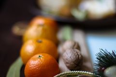 New Year`s decor. Mandarins, walnuts, spruce branches royalty free stock photo
