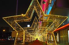 New Year`s decoration installation of a street in the form of a tunnel of stars in Moscow Royalty Free Stock Images