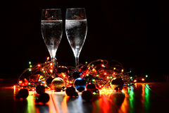 New Year's decorations with champagne glasses Stock Image
