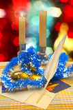 New Year's decorations on the Christmas tree, wax candles, holiday cards royalty free stock photography