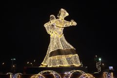 New Year`s decorations and evening festive lighting in Moscow in the form of a waltzing couple Stock Photo