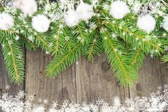 New Year`s decorations,  green  and white. Christmas decoration with green Christmas twigs and snowflakes on a rustic wooden surface Stock Photography