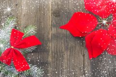 New Year`s decorations, rustic,  red and white. Christmas red flower, branches of Christmas tree, shiny stars and snowflakes on a white background Royalty Free Stock Image