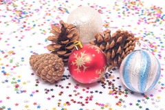 New Year's decorations and spruce cones Stock Photos
