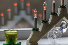 Advent electric candles. New Year`s electric candles on the background of Christmas decorations Stock Images
