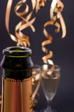New year´s eve. Champagne glasses and bottle, shallow dof, focus is on the bottle Stock Photography