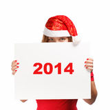 New year's eve advertisement. Woman in new year or christmas hat hiding behind the advertisement isolated on white background Royalty Free Stock Photography