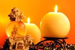 New Year's Eve - Burning Candles and Snow Globe Stock Image