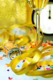 New Year's Eve Celebration. Glasses and bottle of champagne with festive ribbons Stock Photo