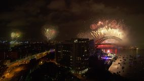 New year`s eve celebration in Australia. A wide shot of fireworks as the new year`s eve occurs. The harbour bridge is seen in the background stock footage
