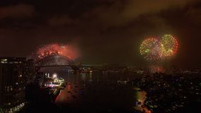 New year`s eve celebration in Sydney. An extreme wide shot of during the New year`s eve. Fireworks are being lit simultaneously across Sydney stock video
