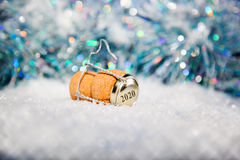 New Year's Eve/Champagne cork new year's 2020. New Year's Eve/Champagne cork  in the snow new year's 2020 Royalty Free Stock Images