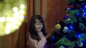 New Year's Eve, Christmas the child decorate the Christmas tree stock video footage