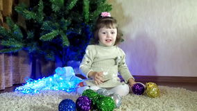 New Year's Eve, Christmas the child decorate the Christmas tree stock footage