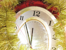 New years eve. The clock is decorated with Christmas tinsel on the eve of the New year Royalty Free Stock Photography